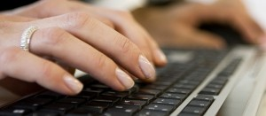 A woman's hands on a keyboard. Ready to Experience Hybrid MT after SYSTRAN's webinar on Thursday, September 18, 2014