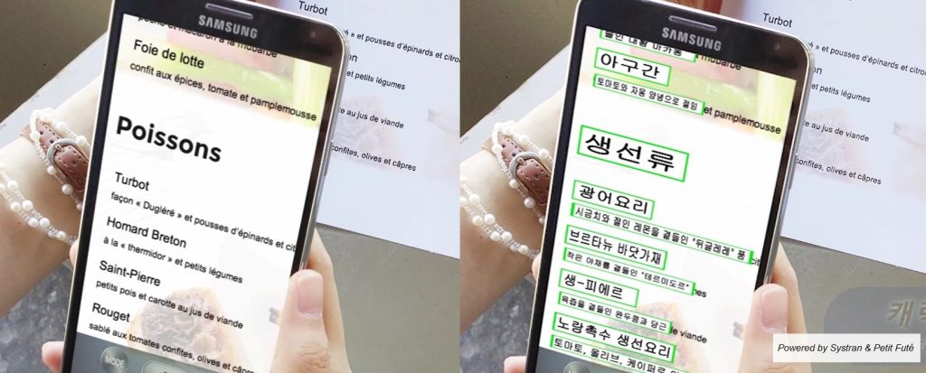 Someone is holding a smartphone and translate something into Korean.