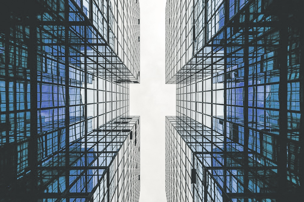 View to the sky between two buildings : sky is the limit at the FIBA AML Conference. SYSTRAN will showcase its newest translation software, Pure Neural Machine Translation