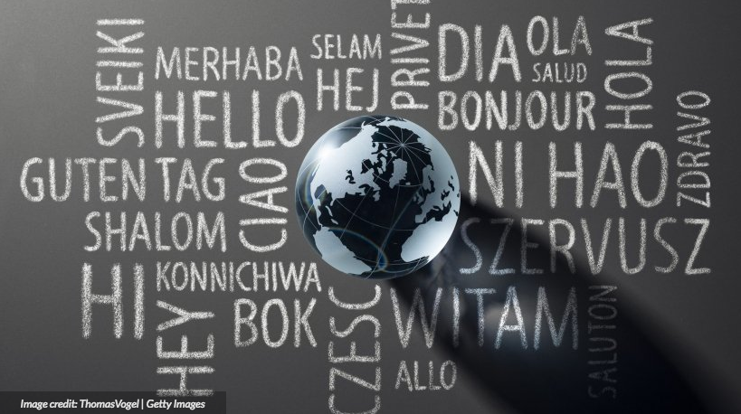"illustration of a globe and the word ""hello"" translated into different languages. Translation Tech is the key"