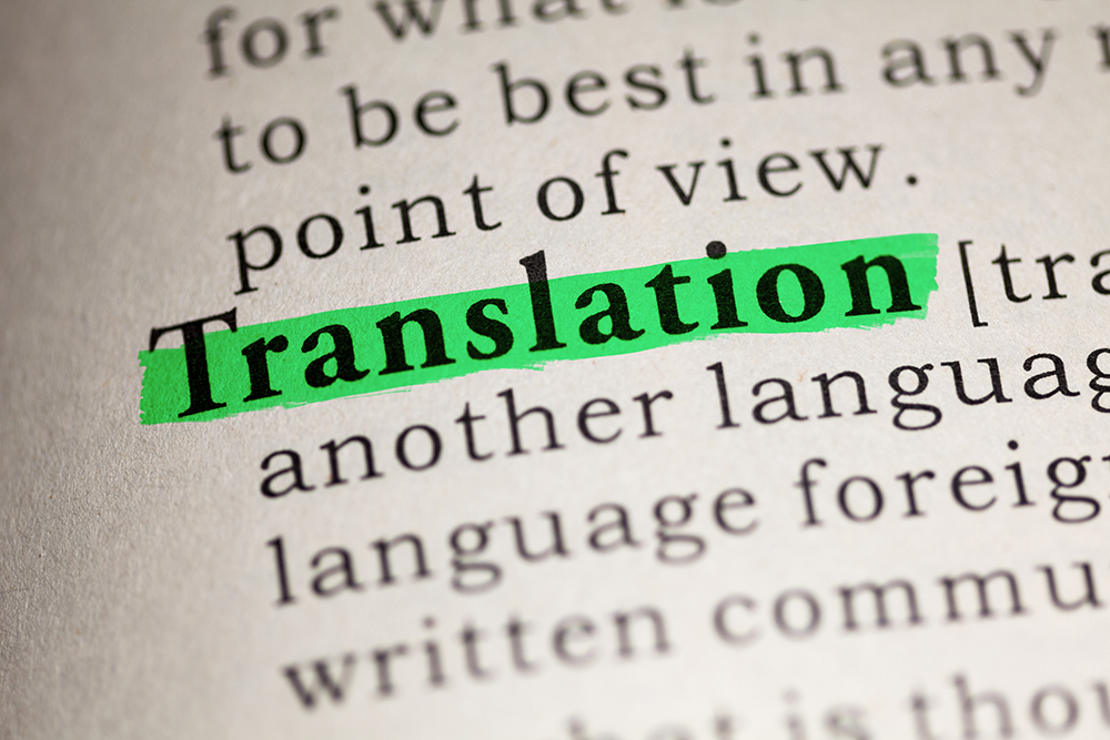 "A book in which the word ""translation"" is highlighted in green. SYSTRAN show the importance of translation in business & in life in general."